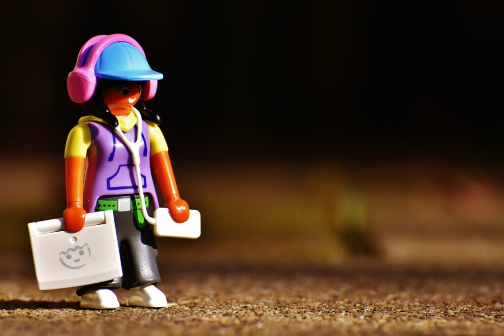 Minifigure with headphones and laptop